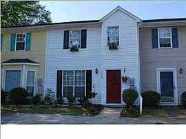 Spacious 2 Bedroom Townhouse with Hardwoods and Fenced Yard